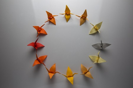 origami paper: Colorful Origami birds flying to the light.