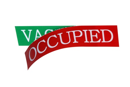 The vacancy sign is replaced by occupied sign Stock Photo