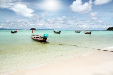 Long tail boats near the sand beach at Koh Lipe, Thailand Stock Photo - 16479503