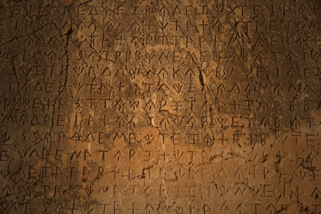 A Greek inscription carved in stone at ancient ruins Stock Photo