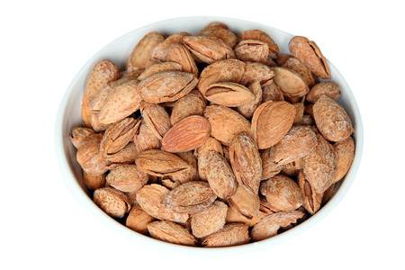Shelled Almonds in a white bowl Stock Photo