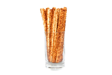 pretzel sticks in a glass on white  photo