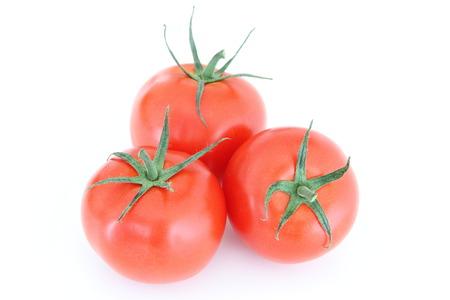 Fresh tomato isolated on white  Stock Photo