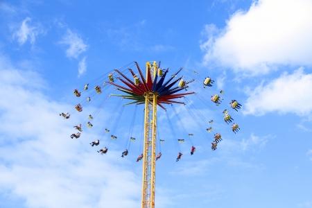 marry go round: swing ride in amusement park