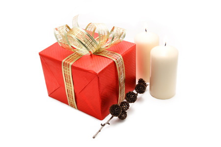 Red gift box with pine cone and candles photo