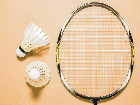 shuttlecock: sports set of two shuttlecocks with badminton racket on plywood background Stock Photo