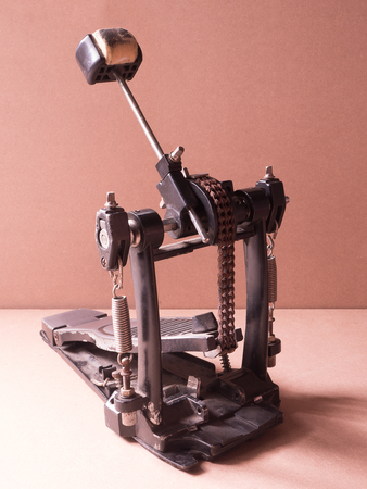 Old Pedal drum on brown background