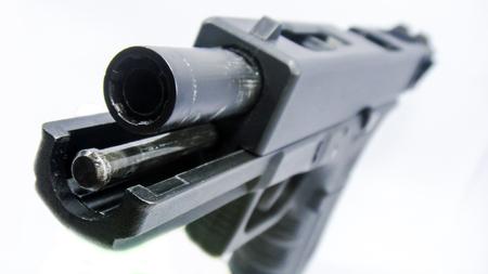 Handgun unload bullet in barrel isolated on white background