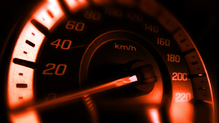 Close up shot of a speed meter in a car with orange light Stock Photo