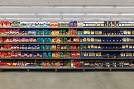 Pasta on shelf. Pasta Packaging in a supermarket on a shelf. Suitable for presenting new product plans and new packaging among many others.
