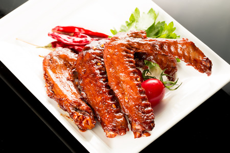 Braised duck wings, Chinese cuisine. photo