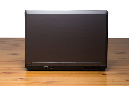 back view of a elite laptop, it is designed for working  photo