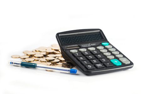 financal: many coins and Calculator on a white background for financal contents Stock Photo