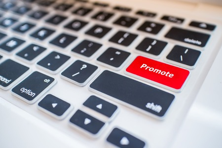 promote: Close-up view on conceptual keyboard - Promote (red key)