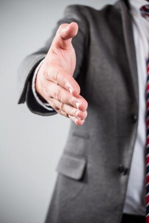 bridging the gaps: a man gives a hand toward to the camera
