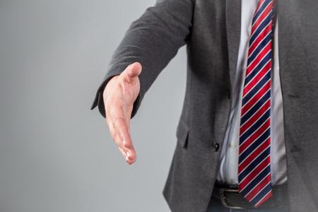 bridging the gap: a man gives a hand toward to the camera