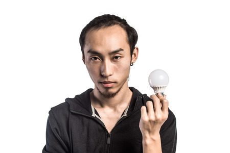cree: young man, holding the LED bulb in his hand Stock Photo