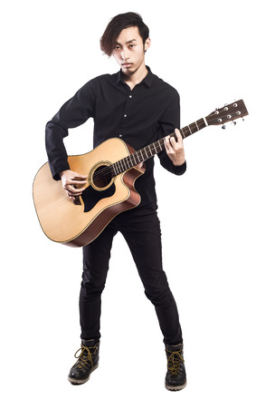 man with camera: Young man playing guitar on white background looking to the camera Stock Photo
