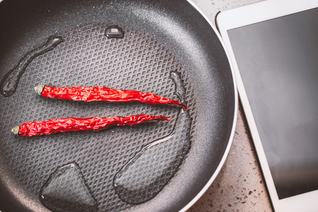 parch: Red Chilli Peppers in a Frying Pan good photo