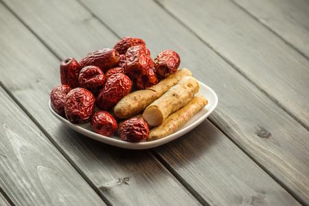 wild yam: breakfast wih yam dates and Oranges goods Stock Photo