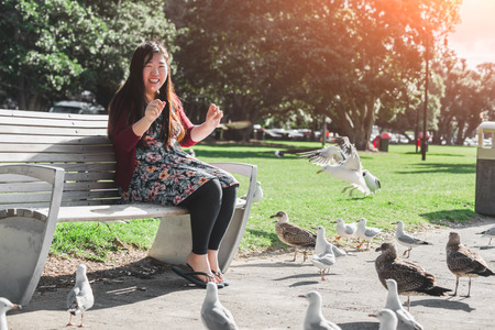 sits on a chair: Girl sits on a chair play with seagull nice shot