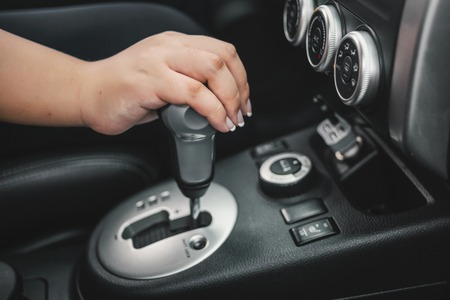 shifting: hand on automatic gear shift, Man hand shifting an automatic car
