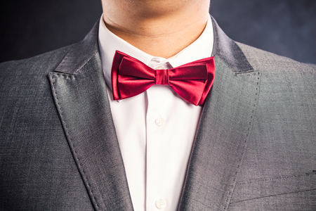 exacting: Fashion photo of a man correcting his bowtie nice photo