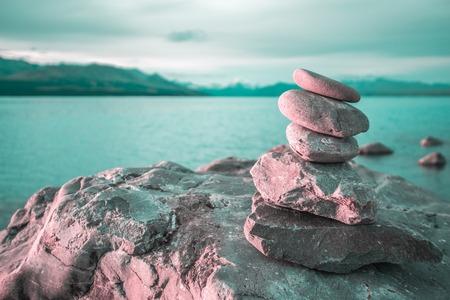 fulcrum: Zen stones on beach pukaki lake