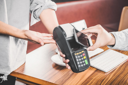 telecast: Customer using mobile phone for pay by the bill