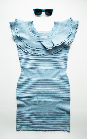 sleeveless dress: sleeveless dress with pleated skirt isolated over white