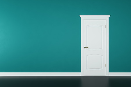 Closed white door on teal wall background photo