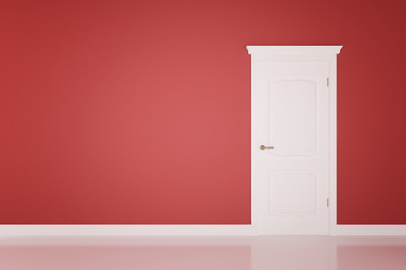 Closed white door on red wall background photo