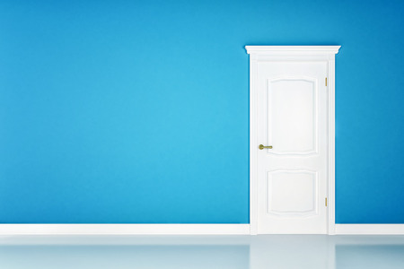 Closed white door on blue wall background photo