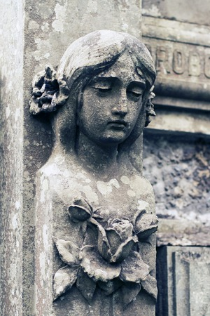 churchyard: Old statue woman on grave in the Lychakivskyj cemetery of Lviv, Ukraine. Stock Photo