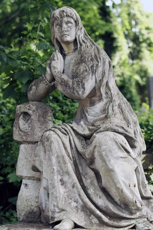 eminence: Old statue woman on grave in the Lychakivskyj cemetery of Lviv, Ukraine. Stock Photo