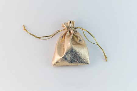 Filled gold sack isolated on white background photo