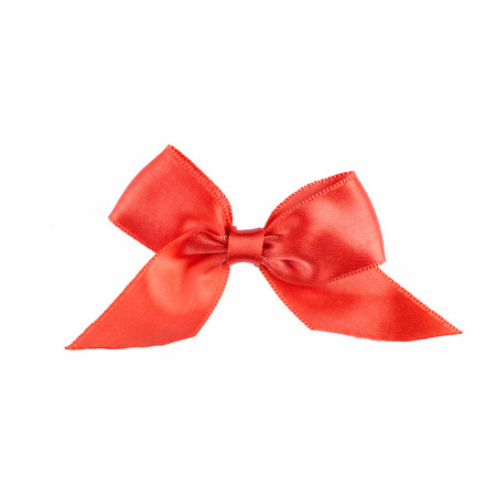 new year s day: Red ribbon bow with tails isolated on white background