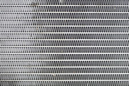 discarded metal: car radiator background abstract pattern