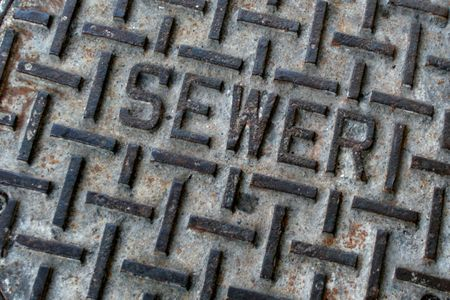 sidewalk sewer hatch, hole cover photo