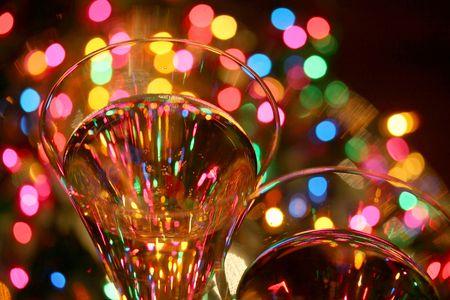 crystal glasses, sparkling wine, festive lights....celebrate! brighter version Stockfoto