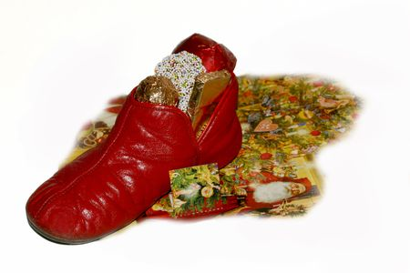 night before christmas: December 6th goodies; vintage childs slipper with chocolate, candy from Knecht RuprechtSaint Nikolaus Stock Photo