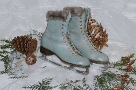 jack frost: vintage ice skates on snow with jack frost ice pattern Stock Photo