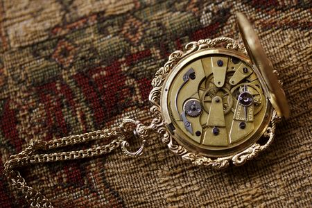 antique ladies watch with clockwork mechanism exposed