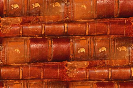 repeated: antique worn leather books in repeated pattern