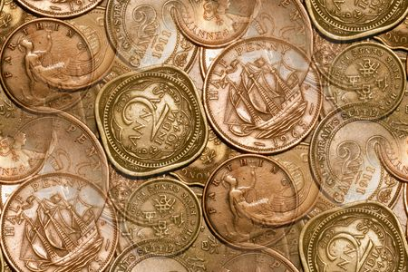vintage coin abstract with English  Indian in forefront, other English coins, along with Straits Settlement, Hong Kong, Canada and Ireland also included. Stockfoto