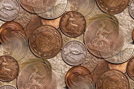 britannia: vintage coin background abstract with New Zealand, Canadian English coins in forefront, Straits Settlement, Hong Kong, &amp, Ireland, along with other English Canadian coins are also represented.