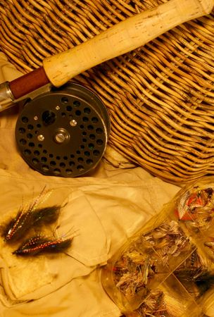 fished: vintage fishing creel. been fished rod, reel, tackle & vest Stock Photo
