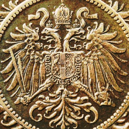 background based on double eagle detail from an old Austrian 2 heller coin photo