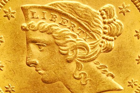Liberty head detail from a US five dollar gold coin Stock Photo