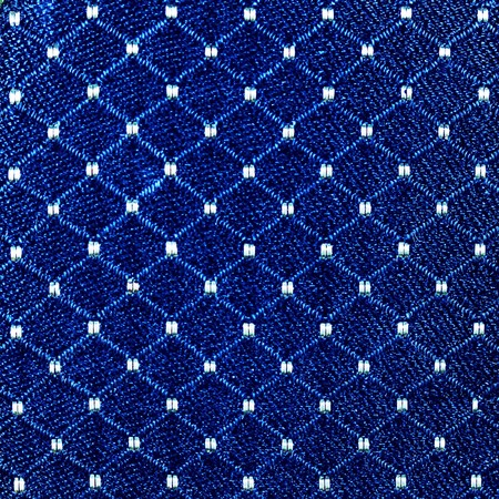 crosshatch: fabric detail on vintage ladies compact Stock Photo
